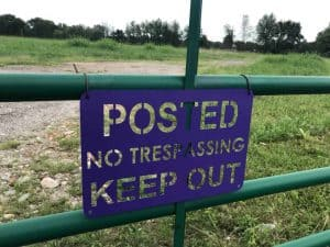 posted-no-trespassing-sign-on-gate