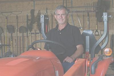 tractor inside machine barn